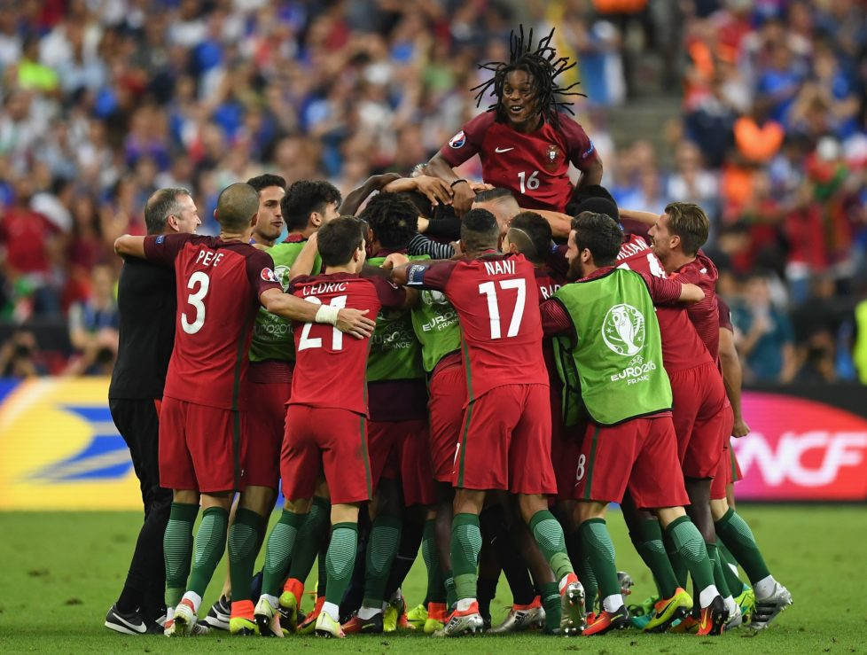 PARIS, FRANCE - JULY 10: Renato Sanches (top) and Portugal players celebrate their team's first goal scored by Eder (obscured) during the UEFA EURO 2016 Final match between Portugal and France at Stade de France on July 10, 2016 in Paris, France. (Photo by Laurence Griffiths/Getty Images)