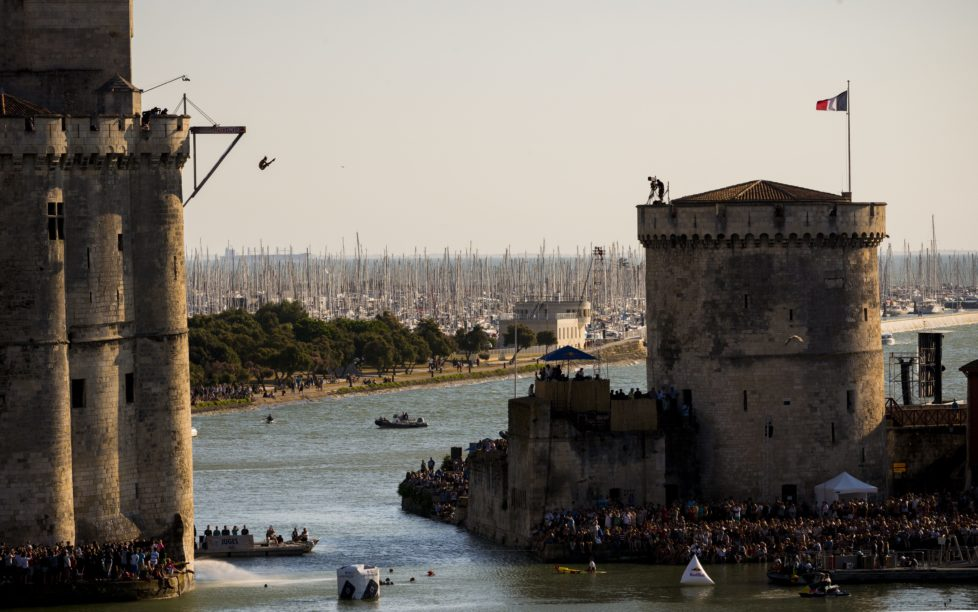 LA ROCHELLE, FRANCE - JULY 23: (EDITORIAL USE ONLY) In this handout image provided by Red Bull, Jucelino Junior of Brazil dives from the 27 metre platform on the Saint Nicolas Tower during the fourth stop of the Red Bull Cliff Diving World Series, La Rochelle, France. (Photo by Vincent Curutchet/Red Bull via Getty Images)