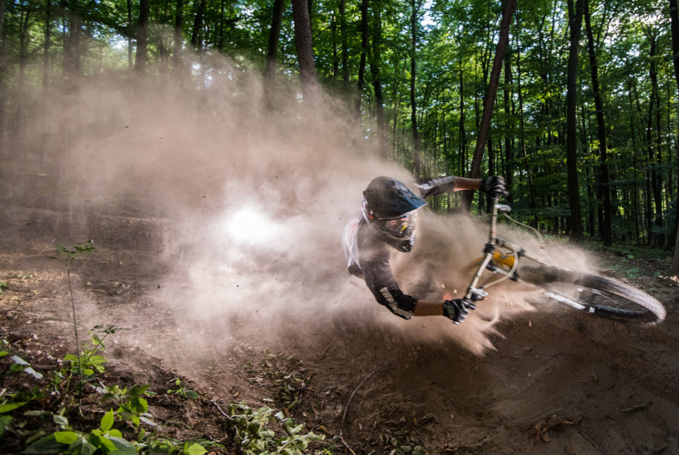 DARMSTADT, GERMANY - JULY 29: A downhill mountain biker performs at the so called 'Rinne' at the mountain 'Frankenstein' on July 29, 2015 near Darmstadt, Germany. The 'Rinne' is couple of tracks down the hill. The jumps and steep turn are built by young mountain biker. (Photo by Thomas Lohnes/Getty Images)