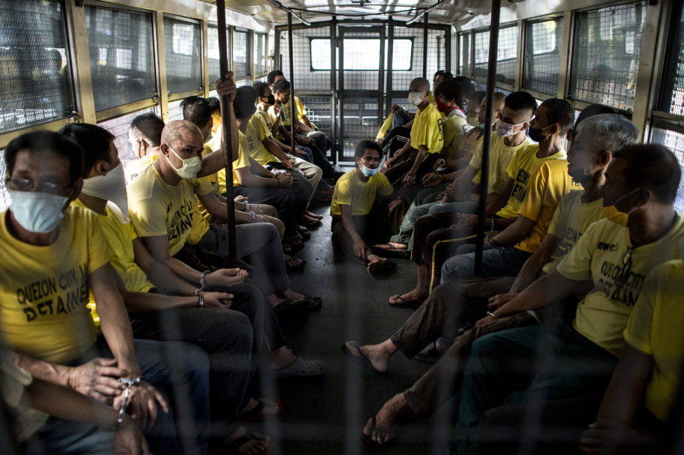 Inmates ride on a prison bus to attend their trial at the Quezon City regional trial court in Manila in this picture taken on July 29, 2016. There are 3,800 inmates at the jail, which was built six decades ago to house 800, and they engage in a relentless contest for space. Men take turns to sleep on the cracked cement floor of an open-air basketball court, the steps of staircases, underneath beds and hammocks made out of old blankets. / AFP PHOTO / NOEL CELIS / TO GO WITH AFP STORY: Philippines-politics-crime-jails, FOCUS by Ayee Macaraig