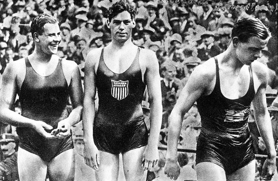 "1924 Olympic Games, Paris, France, Men's 400 Metres Freestyle Swimming, USA's Johnny Weissmuller (C) who won the gold medal in the race with Australia's Andrew ""Boy"" Charlton (R) who took bronze and Swden's A, Borg (L) who took silver (Photo by Popperfoto/Getty Images)"