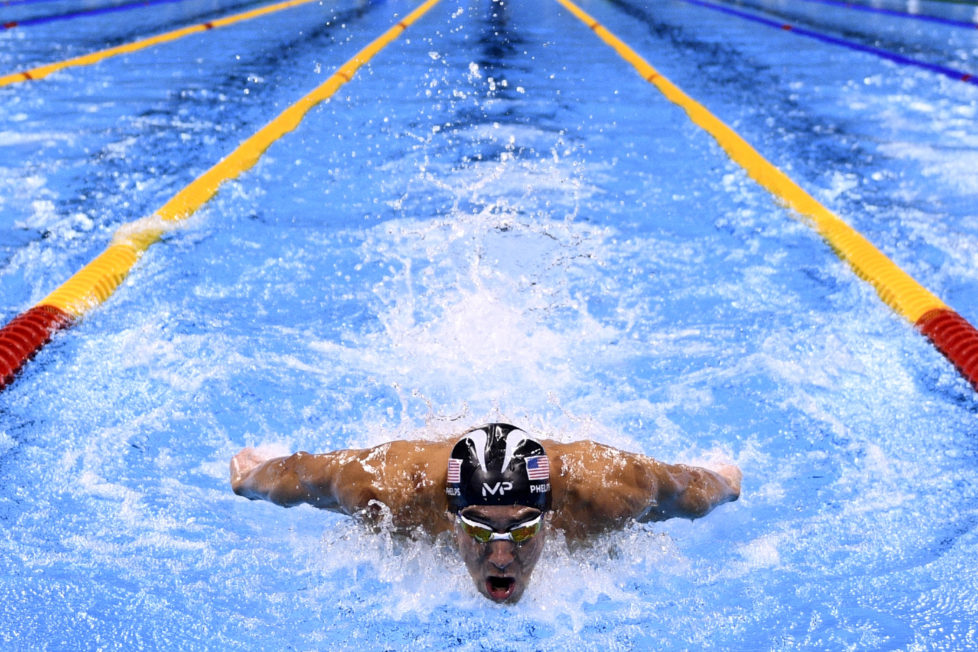 USA's Michael Phelps competes in the Men's 200m Individual Medley Semifinal during the swimming event at the Rio 2016 Olympic Games at the Olympic Aquatics Stadium in Rio de Janeiro on August 10, 2016. / AFP PHOTO / Martin BUREAU