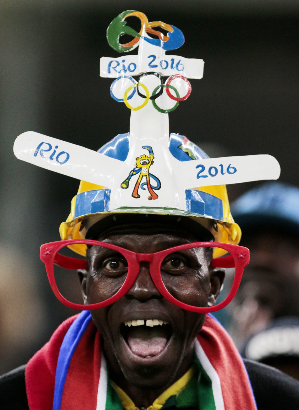 Fans of South Africa cheer their team during their Rio 2016 Olympic Games First Round Group A men's football match South Africa vs Iraq at the Corinthians Arena, in Sao Paulo, Brazil, on August 10, 2016. / AFP PHOTO / Miguel SCHINCARIOL