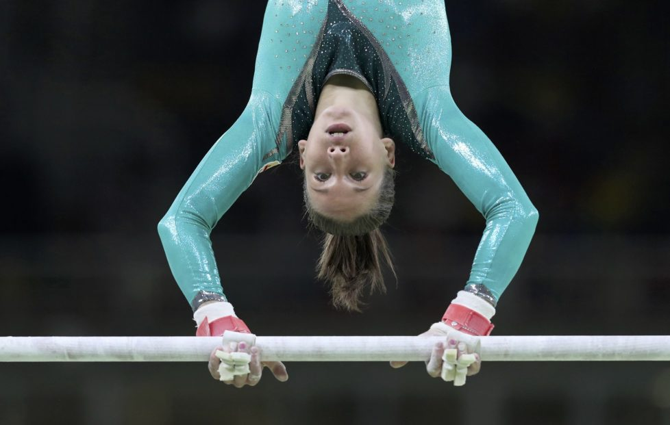 2016 Rio Olympics - Artistic Gymnastics - Preliminary - Women's Qualification - Subdivisions - Rio Olympic Arena - Rio de Janeiro, Brazil - 07/08/2016. Zsofia Kovacs (HUN) of Hungary competes on the uneven bars during the women's qualifications. REUTERS/Damir Sagolj FOR EDITORIAL USE ONLY. NOT FOR SALE FOR MARKETING OR ADVERTISING CAMPAIGNS.