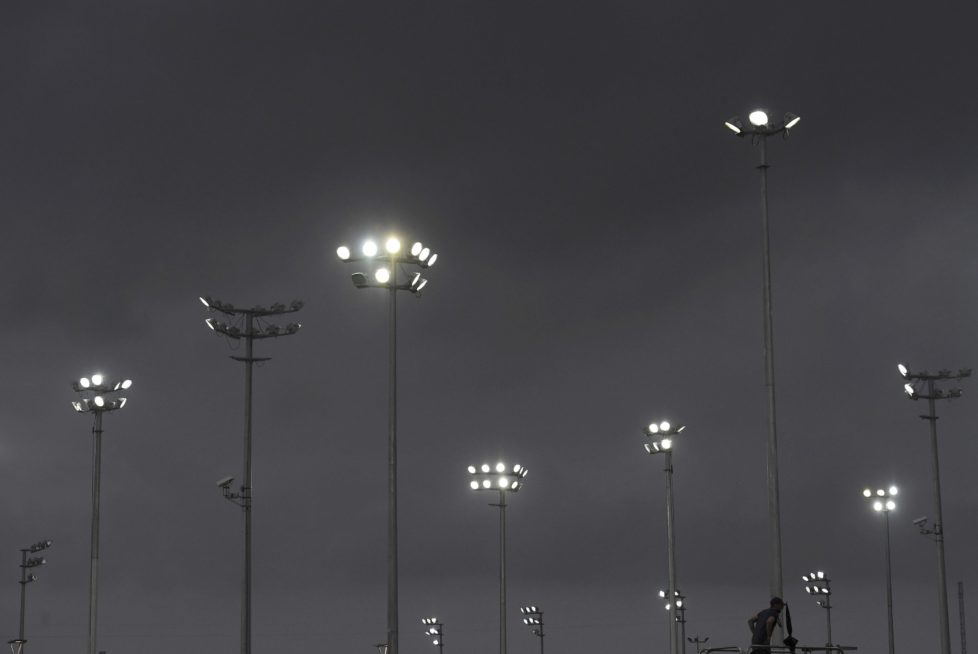 2016 Rio Olympics - Tennis - Olympic Tennis Centre - Rio de Janeiro, Brazil - 07/08/2016. A man stands among stadium lights at the Olympic Tennis Centre. REUTERS/Toby Melville TPX IMAGES OF THE DAY. FOR EDITORIAL USE ONLY. NOT FOR SALE FOR MARKETING OR ADVERTISING CAMPAIGNS.