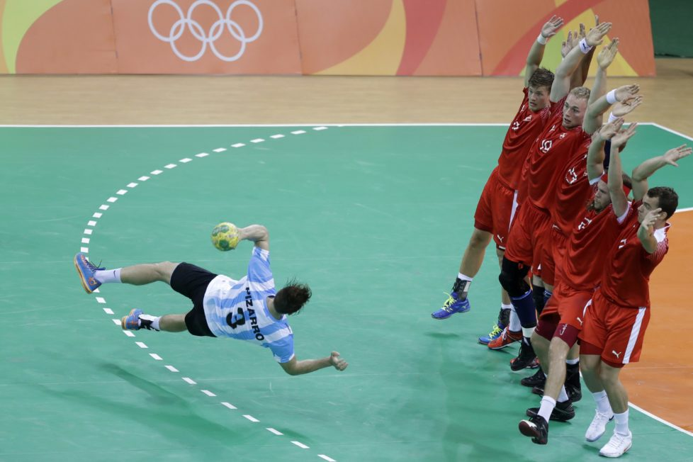 Argentina's Federico Pizarro tries to score a penalty during the men's preliminary handball match between Denmark and Argentina at the 2016 Summer Olympics in Rio de Janeiro, Brazil, Sunday, Aug. 7, 2016. (AP Photo/Matthias Schrader)