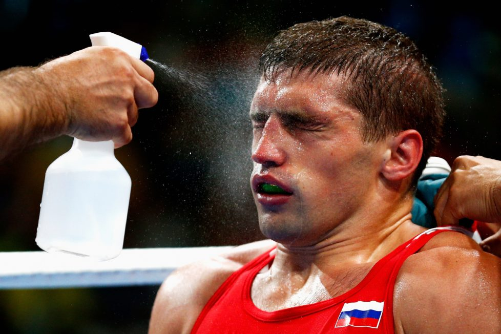 RIO DE JANEIRO, BRAZIL - AUGUST 07: Petr Khamukov of Russia has water sprayed on his face in his corner as he fights against Albert Ramon Ramirez of Venezuela in the Men's Light Heavy 81kg bout on Day 2 of the Rio 2016 Olympic Games at Riocentro - Pavilion 6 on August 7, 2016 in Rio de Janeiro, Brazil. (Photo by Dean Mouhtaropoulos/Getty Images)