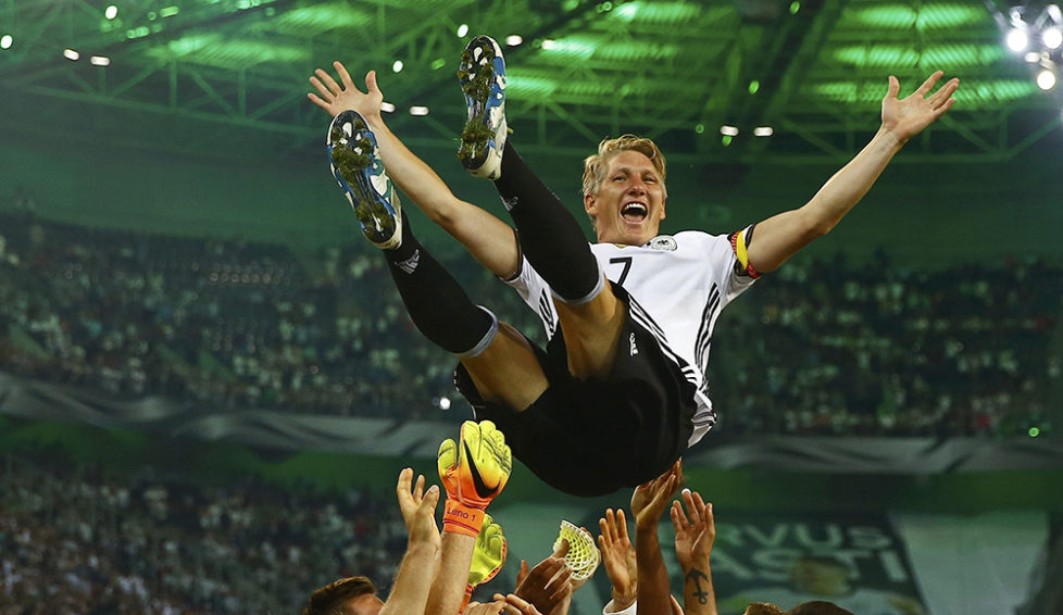Football Soccer - Germany v Finland - Soccer Friendly - Moenchengladbach, Germany - 31/08/16. Germany's Bastian Schweinsteiger gets honoured after the match. REUTERS/Wolfgang Rattay TPX IMAGES OF THE DAY