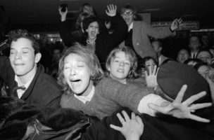 UNITED STATES - FEBRUARY 07:  Beatles' fans are restrained by police at Kennedy Airport.  (Photo by Hal Mathewson/NY Daily News Archive via Getty Images)