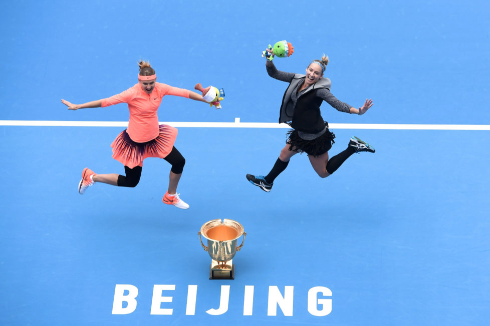 Tennis - China Open Women's double final - Beijing, China - 09/10/16. Bethanie Mattek-Sands of the U.S. and Lucie Safarova of the Czech Republic jump to pose for photos as they hold their trophy after beating France's Caroline Garcia and Kristina Mladenovic. REUTERS/Stringer ATTENTION EDITORS - THIS IMAGE WAS PROVIDED BY A THIRD PARTY. EDITORIAL USE ONLY. CHINA OUT. TPX IMAGES OF THE DAY