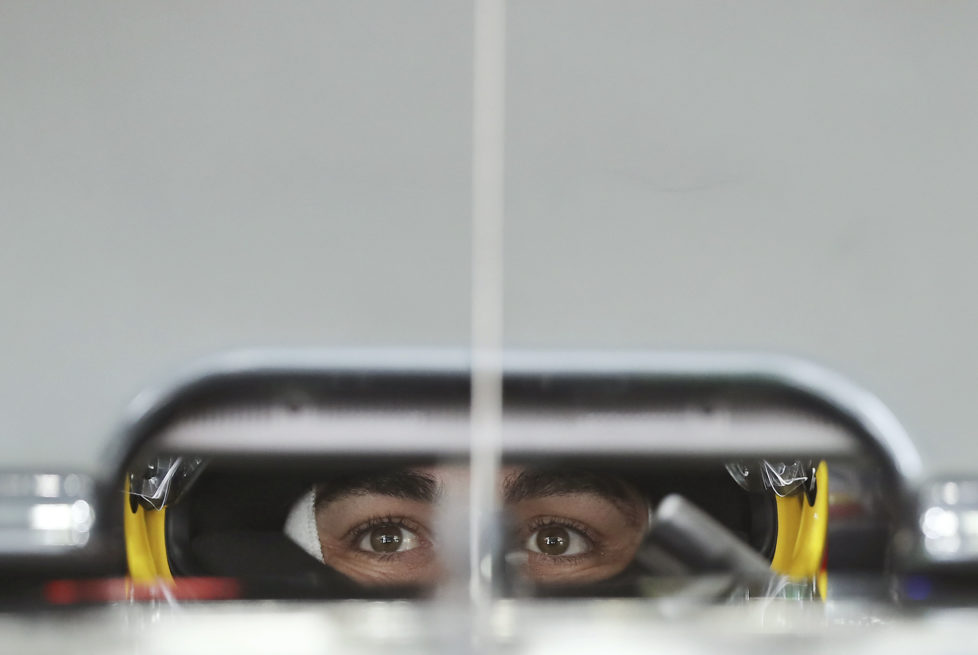 In this Saturday, Oct. 8, 2016 photo, McLaren driver Fernando Alonso of Spain waits in his car at his garage during the third practice session of the Japanese Formula One Grand Prix at the Suzuka International Circuit in Suzuka, central Japan.(AP Photo/Eugene Hoshiko, File)