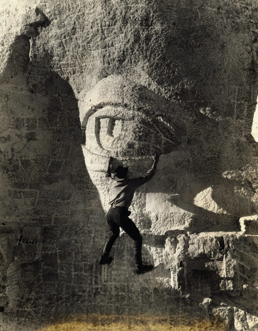 (Original Caption) Hanging on for dear life by the eye lid of the figure of Thomas Jefferson, one of the group on Mount Rushmore is shown. The project is headed by Gutzon Borglum. (Photo by George Rinhart/Corbis via Getty Images)