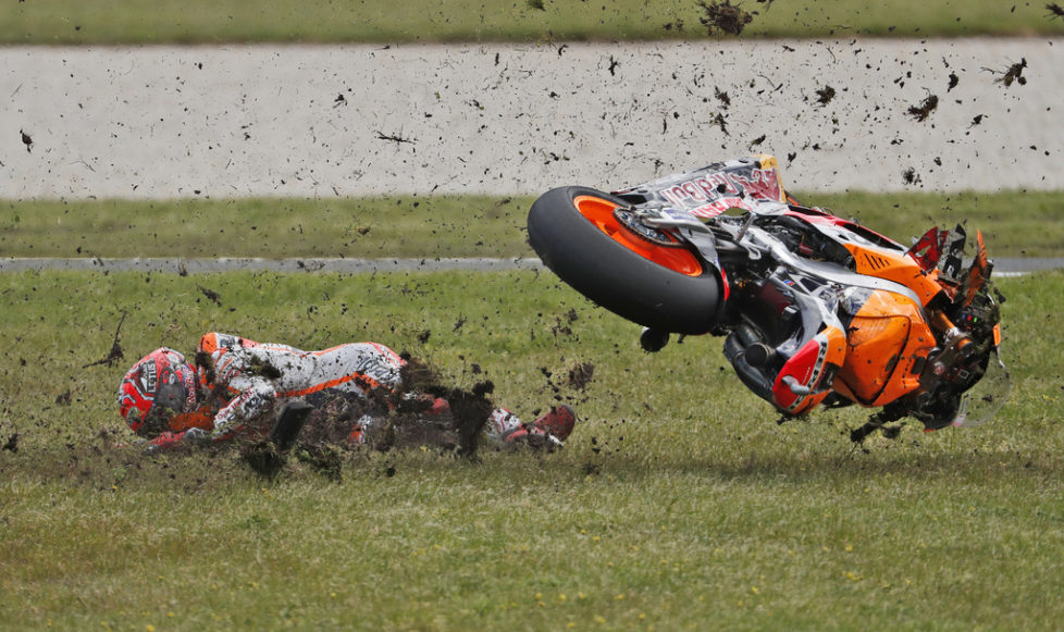 Honda MotoGP rider Marc Marquez of Spain crashes on turn four after leading the the 2016 Australian Motorcycle Grand Prix at Phillip Island near Melbourne, Australia, Sunday, Oct. 23, 2016. (AP Photo/Glenn Nicholls)