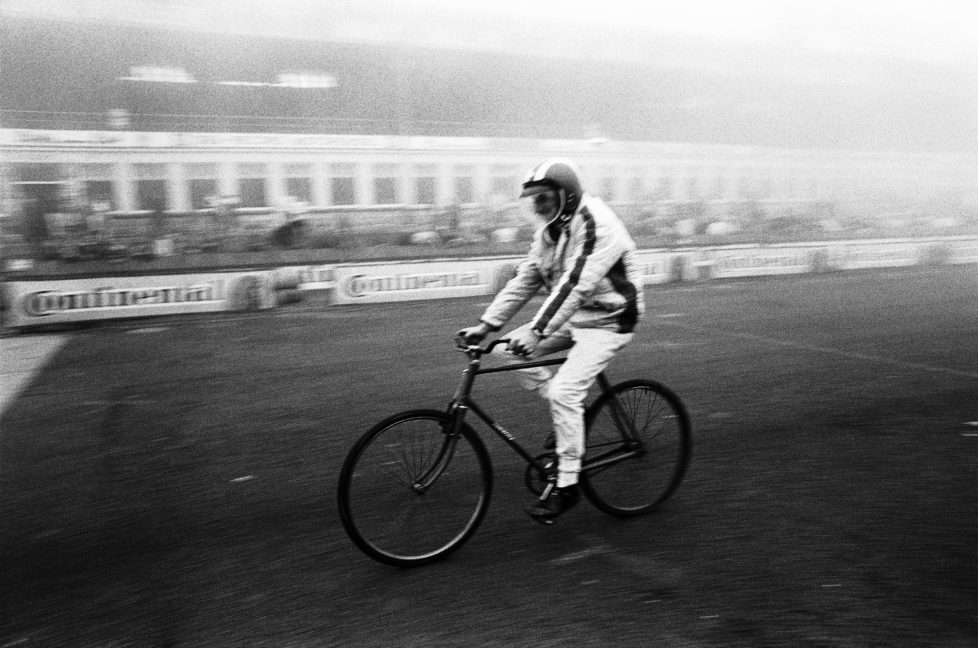 Before the German Grand Prix 1968, Jo Siffert appreciates an informal lap on a bike, Germany, Nuerburgring, 4 August 1968. (Photo by Rainer W. Schlegelmilch/Getty Images) *** Local Caption *** Jo Siffert