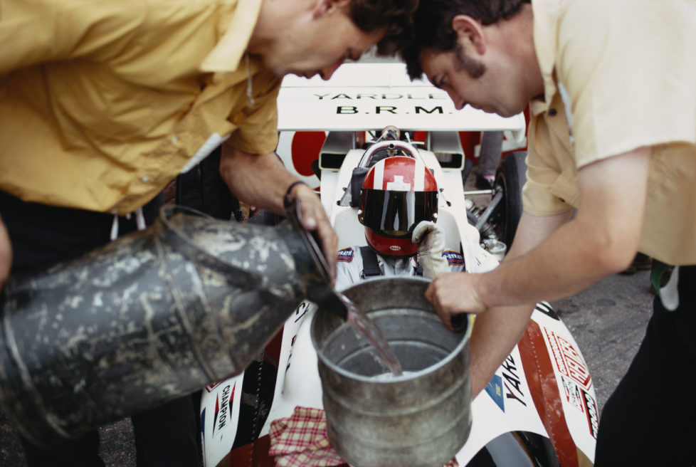 Jo Siffert of Switzerland sits aboard the #9 Yardley-BRM BRM P160 BRM V12 as mechanics refuel the car during practice for the Dutch Grand Prix on 19 June 1971 at the Circuit Zandvoort, Zandvoort, Netherlands. (Photo by Rainer W. Schlegelmilch/Getty Images) *** Local Caption *** Jo Siffert
