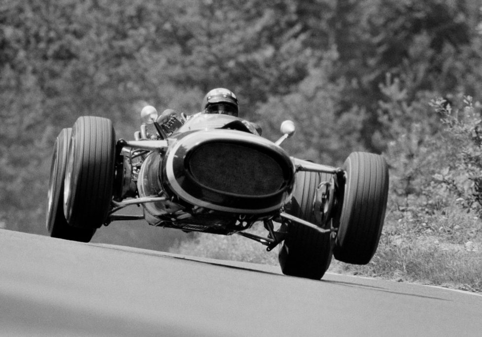 Jo Siffert of Switzerland gets the front wheels off the ground as he drives the #14 Rob Walker Racing Team / Jack Durlacher Cooper T81 Maserati V12 during practice for the German Grand Prix on 5 August 1967 at the Nurburgring near Nurburg, Germany. (Photo by Rainer W. Schlegelmilch/Getty Images) *** Local Caption *** Jo Siffert