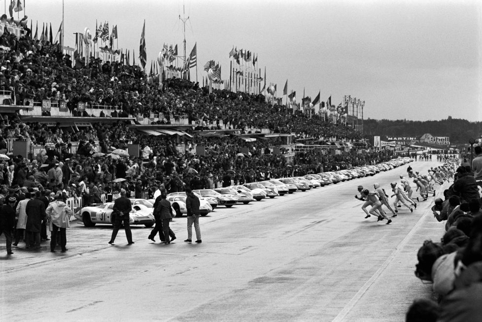 Typical Le Mans start: drivers run to their cars, with Jo Siffert and Rolf Stommelen at the head, France, Le Mans, 28 September 1968. (Photo by Rainer W. Schlegelmilch/Getty Images)