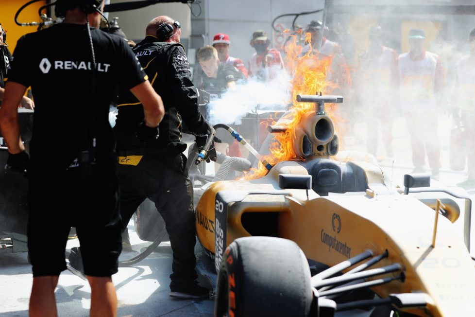 KUALA LUMPUR, MALAYSIA - SEPTEMBER 30: The car of Kevin Magnussen of Denmark and Renault Sport F1 on fire in the Pitlane during practice for the Malaysia Formula One Grand Prix at Sepang Circuit on September 30, 2016 in Kuala Lumpur, Malaysia. (Photo by Mark Thompson/Getty Images)