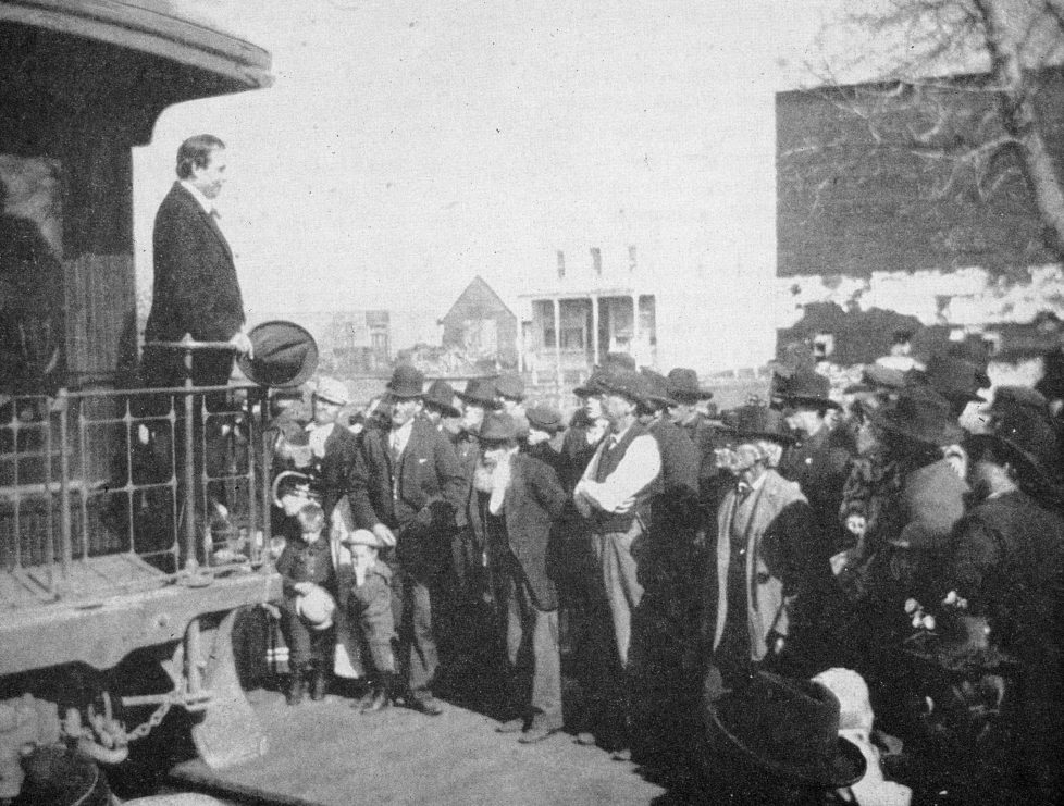 Democratic presidential candidate William Jennings Bryan (1860 - 1925) addresses a crowd from a railroad caboose during his national campaign whistle-stop tour, 1896. (Photo by Kean Collection/Getty Images)