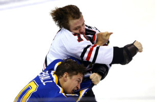 Nov 9, 2016; St. Louis, MO, USA; Chicago Blackhawks left wing Artemi Panarin (72) and St. Louis Blues right wing Scottie Upshall (10) brawl during the third period at Scottrade Center. The Blackhawks won 2-1 in overtime. Mandatory Credit: Billy Hurst-USA TODAY Sports     TPX IMAGES OF THE DAY