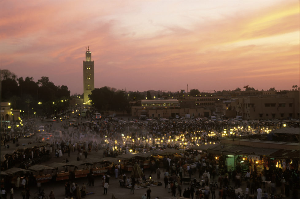 The Djemaa el Fna square in Marrakech at sunset, with the Koutoubia Mosque in the background, circa 1980. (Photo by Romano Cagnoni/Getty Images)
