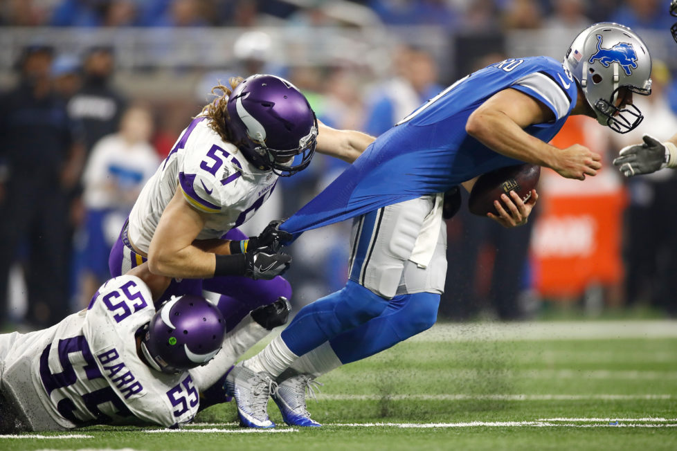 DETROIT.MI - NOVEMBER 24: Audie Cole #57 of the Minnesota Vikings and Anthony Barr (55) try to drag down quarterback Matthew Stafford (9) of the Detroit Lions during second half action at Ford Field on November 24, 2016 in Detroit, Michigan. (Photo by Gregory Shamus/Getty Images) *** BESTPIX ***
