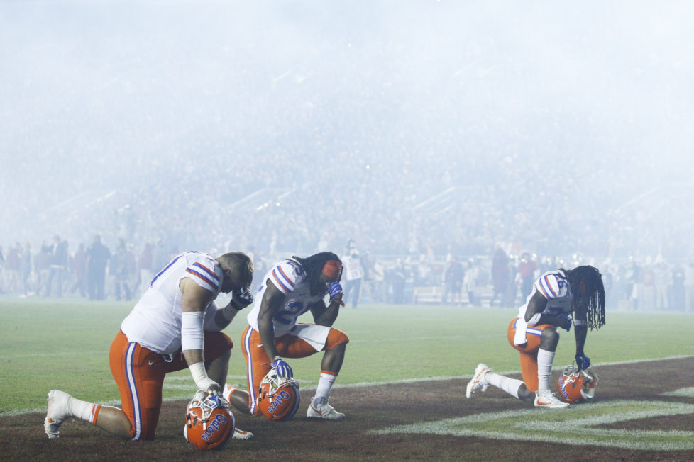 TALLAHASSEE, FL - NOVEMBER 26: A trio of Florida Gators players kneel to pray before the game against the Florida State Seminoles at Doak Campbell Stadium on November 26, 2016 in Tallahassee, Florida. (Photo by Joe Robbins/Getty Images) ***BESTPIX***