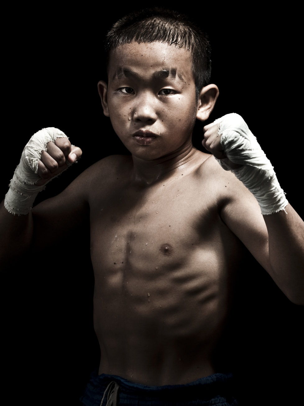 "Muay Thai Kickboxing fighter Petchwiengian of Laos poses at Sangmorakot gymnasium in Bangkok, Thailand. Muay Thai, also know as ""Art of Eight Limbs"", is a combat martial art and Thailand's national sport. (Photo by Victor Fraile/Corbis via Getty Images)"