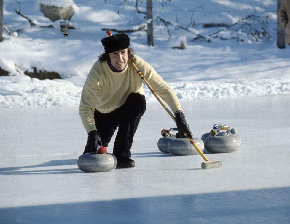 Sport, Motor Racing, pic: Gstaad, Switzerland, British racing driver Jackie Stewart playing the sport of curling during a break in Switzerland, Jackie Stewart, a Scot, was Formula One World Champion three times in 1969, 1971, and 1973 (Photo by Rolls Press/Popperfoto/Getty Images)