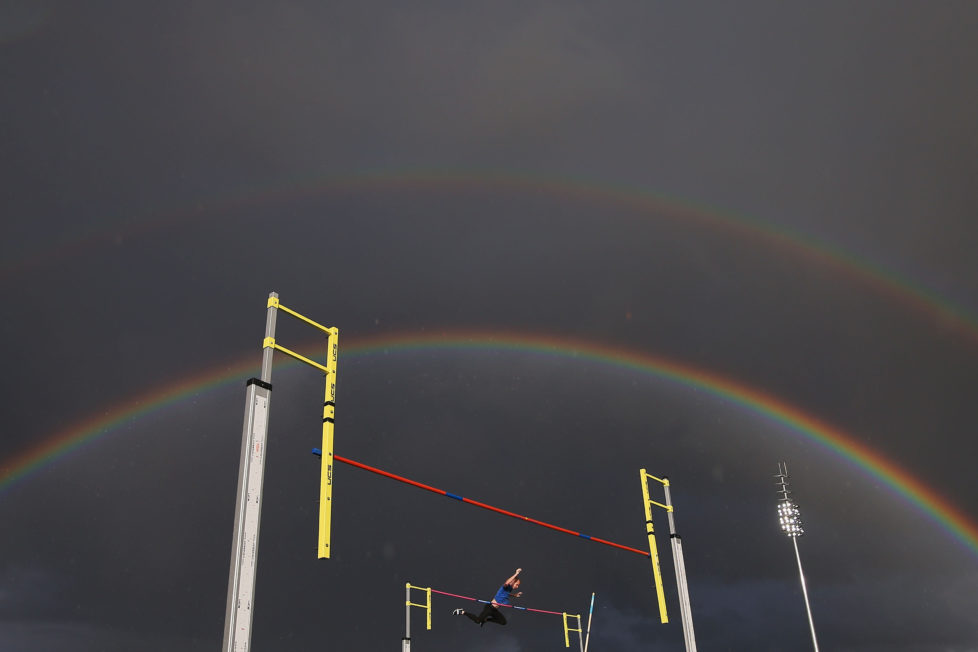 MELBOURNE, AUSTRALIA - DECEMBER 08: A rainbow appears as a male athlete competes in the Steve Hooker Pole Vault Challenge during the Zatopek 10 Australian 10,000m Championships on December 8, 2016 in Melbourne, Australia. (Photo by Michael Dodge/Getty Images) *** BESTPIX ***