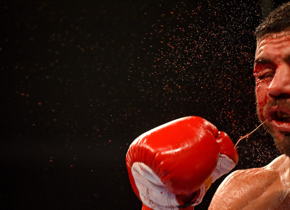 LOS ANGELES, CA - DECEMBER 10: Lenny Zappavigna, (red gloves) from New South Wales, Australia during his during his IBF Junior Welterweight Bout against Sergey Lipinets, (blue gloves) from Moscow, Russia, at the Galen Center at the University of Southern California on December 10, 2016 in Los Angeles, California. Lipinets won by knockout. (Photo by Jayne Kamin-Oncea/Getty Images)