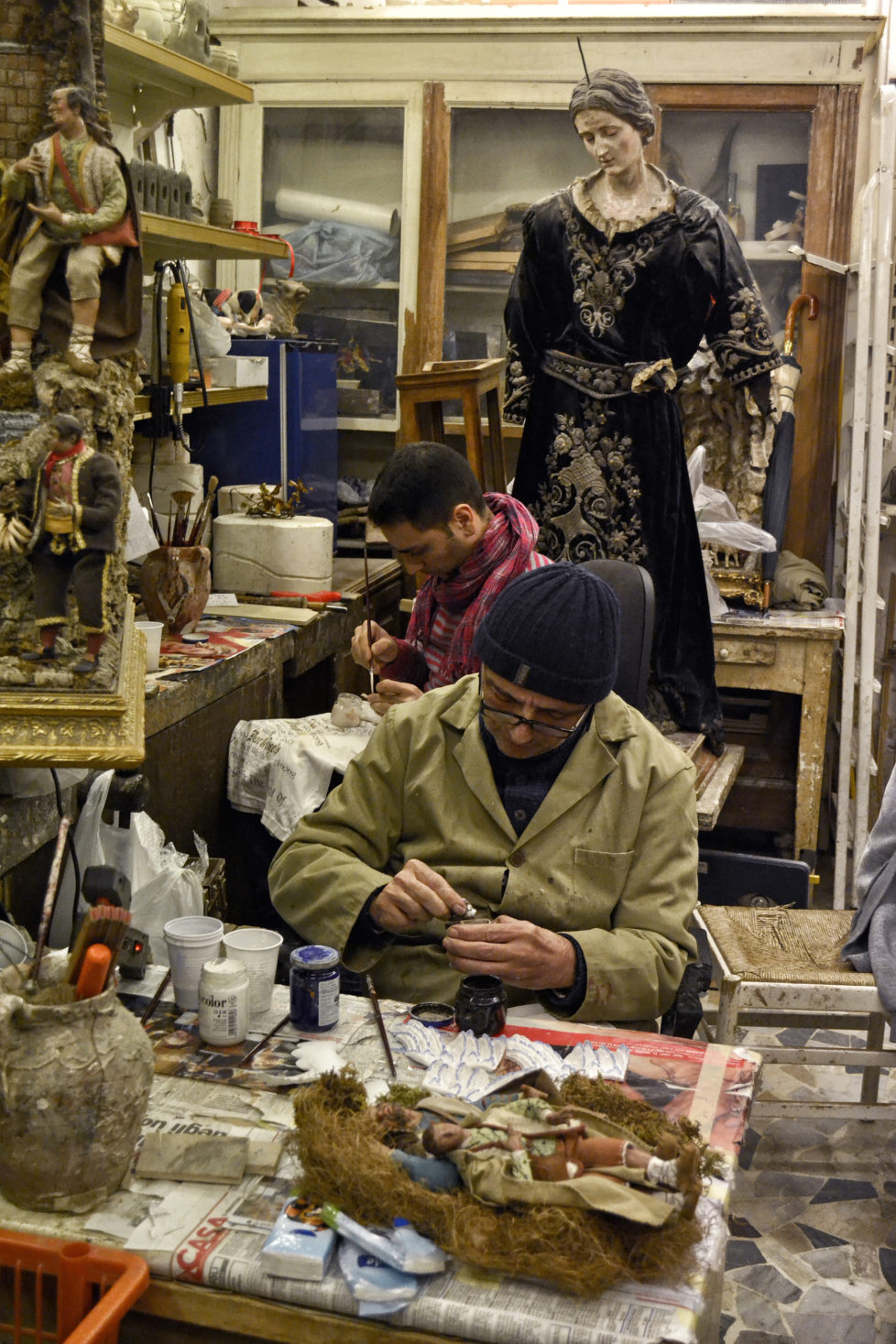 "[UNVERIFIED CONTENT] Luigi Cesarini and his son Giuseppe working at the handmade crib figurines in their workshop Via San Gregorio Armeno, in Napoli. They perform accurate artistic works in different materials: wood, clay, cartapesta. Via San Gregorio Armeno is a street in the historic center of Naples, famous for tourist for hosting many artisan of handmade Nativity scenes (in italian ""presepe""). Naples, December 3, 2013. ? Antonio Ciufo"
